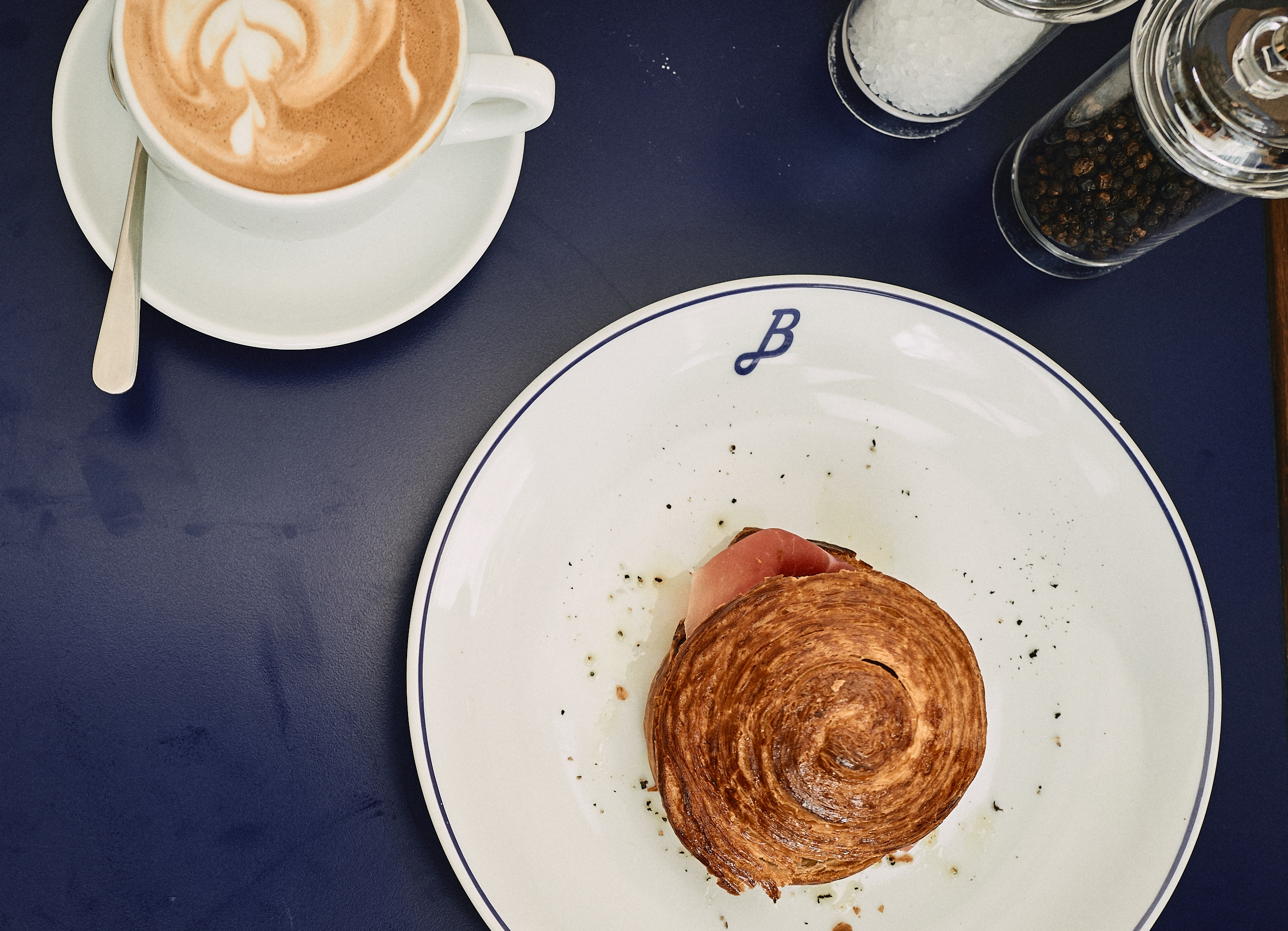 Perfect cappuccino with a croissant filled with Parma Ham: the best way to start the day!